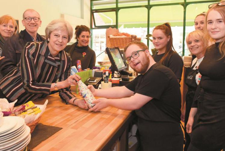 Theresa May filling up reusable waterbottle in maidenhead